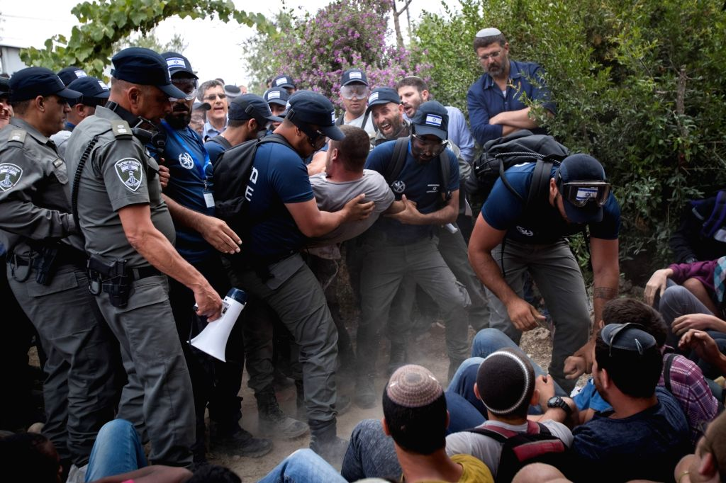 NETIV HA'Israeli police forces evict people from the outpost of Netiv Ha'avot in the West Bank, on June 12, 2018. Clashes between Israeli settlers and police erupted ...