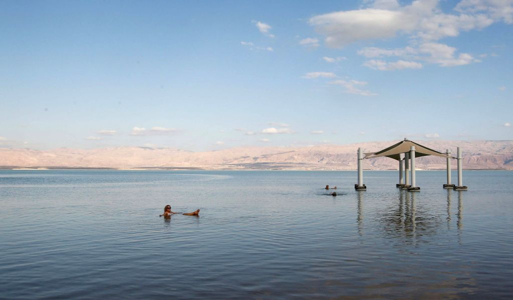 NEVE ZOHAR, Dec. 29, 2019 - Tourists enjoy themselves in the southern part of the Dead Sea near the Neve Zohar resort, Israel, Dec. 28, 2019. Neve Zohar is a popular tourist destination for local ...