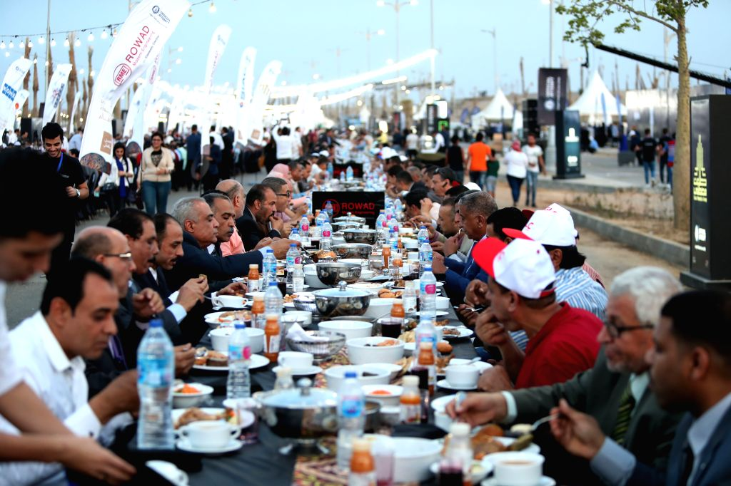 NEW ADMINISTRATIVE CAPITAL (EGYPT), June 1, 2019 People attend a mass iftar, the meal to end their fast at sunset, in Egypt's New Administrative Capital, about 50 kilometers east of ...