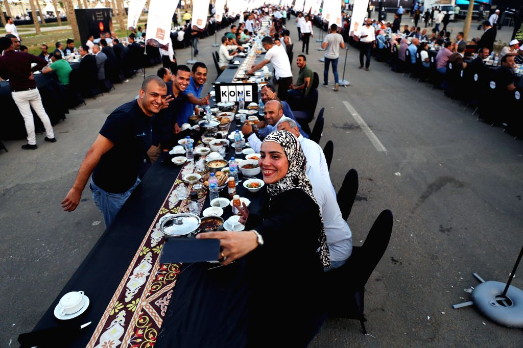 NEW ADMINISTRATIVE CAPITAL (EGYPT), June 1, 2019 A woman takes selfies during a mass iftar, the meal to end their fast at sunset, in Egypt's New Administrative Capital, about 50 ...