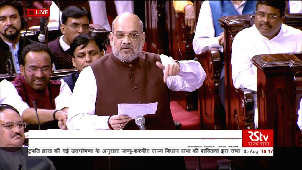 New Dehi: Union Home Minister Amit Shah during debate on Jammu and Kashmir Reorganisation Bill in Rajya Sabha on Aug 5, 2019. - Amit Shah