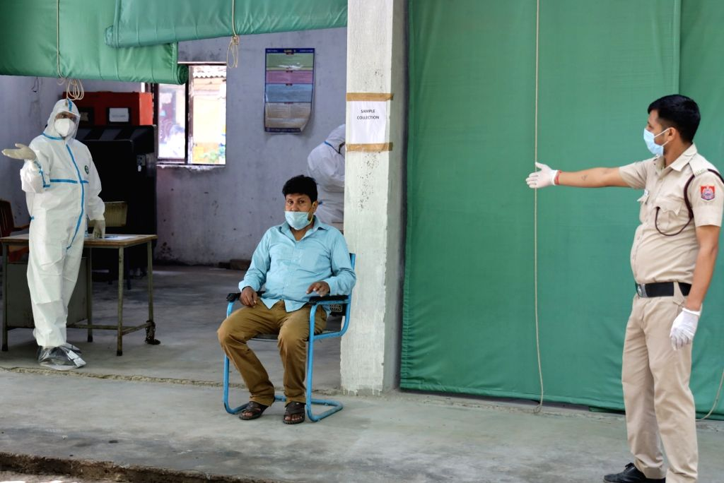 New Delh: People wait to give samples for COVID-19 testing at a coronavirus testing centre set up at a Government school in Delhi's Daryaganj on June 26, 2020.