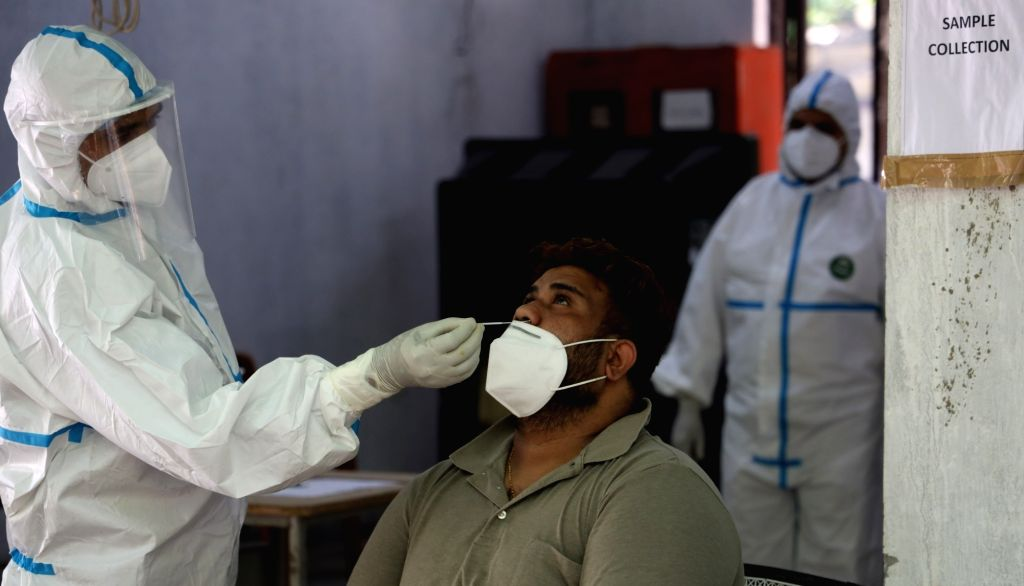 New Delh: Swab samples being collected for COVID-19 testing at a coronavirus testing centre set up at a Government school in Delhi's Daryaganj on June 26, 2020.