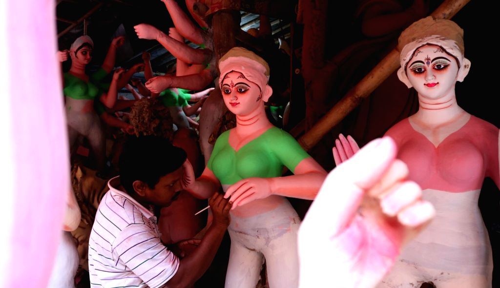 New Delhi:A artist busy making Durga idol at a Delhi workshop ahead of Durga Puja on Sept 29, 2016.