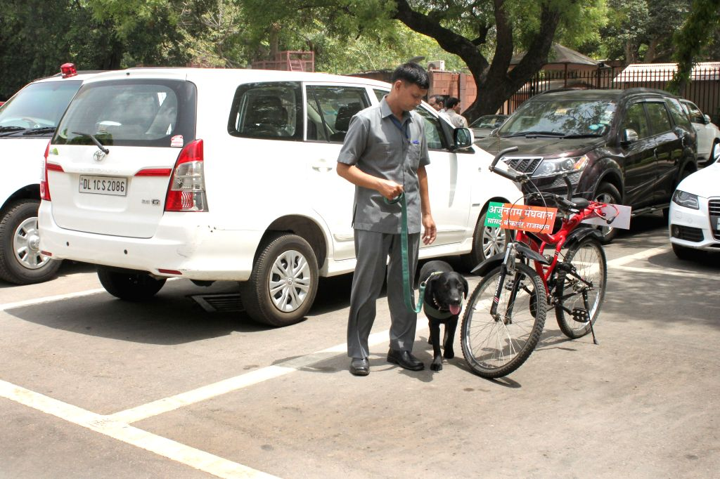 New Delhi A bicycle of BJP MP Arjun Ram Meghwal, parked at Parliament House`s car parking on April 21, 2015.