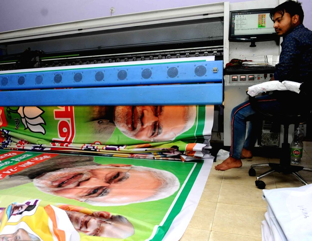 New Delhi: A BJP banner to be used in election campaigning ahead of 2019 Lok Sabha elections, being printed at a press in New Delhi on March 30, 2019. (Photo: IANS)