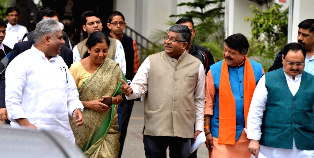 New Delhi: A BJP delegation comprising of Union Ministers Nirmala Sitharaman, Ravi Shankar Prasad and J.P. Nadda come out after meeting the Chief Election Commissioner (CEC) in New Delhi, on March 13, 2019. Also seen BJP leaders Bhupender Yadav and K - Nirmala Sitharaman, Ravi Shankar Prasad, J. and Bhupender Yadav
