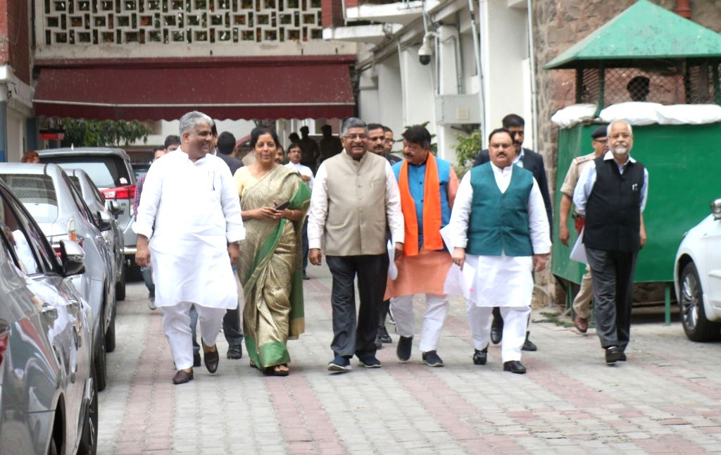New Delhi: A BJP delegation comprising of Union Ministers Nirmala Sitharaman, Ravi Shankar Prasad and J.P. Nadda arrive after meeting the Chief Election Commissioner (CEC) in New Delhi, on March 13, 2019. Also seen BJP leaders Bhupender Yadav and Kai - Nirmala Sitharaman, Ravi Shankar Prasad, J. and Bhupender Yadav