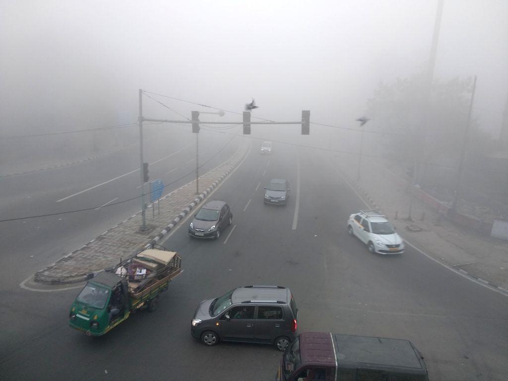 New Delhi: A blanket of fog engulfs New Delhi, on Jan 18, 2019. (Photo: IANS)