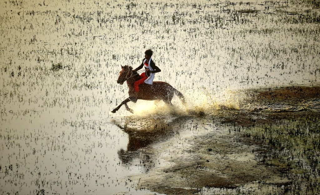 New Delhi : A boy riding a horse on the water of the Yamuna river near Yamuna khadar in New Delhi on  Tuesday 25 May 2021.