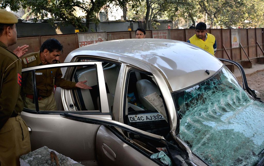 A car that was flattened after a section of an under-construction flyover collapsed on it in New Delhi's northwestern area of Pitampura on Feb 12, 2015.  At least three people were injured