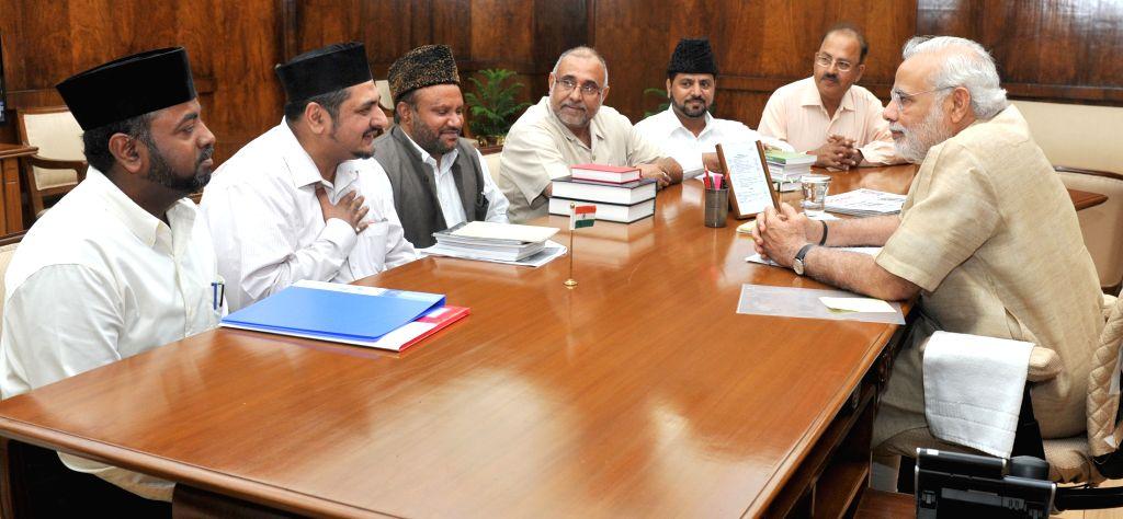 A delegation of Ahmadiyya Muslim Community, accompanied by Rajya Sabha member Avinash Rai Khanna calls on Prime Minister Narendra Modi, in New Delhi on April 30, 2015. - Narendra Modi and Avinash Rai Khanna