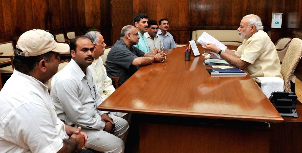 A delegation of West Pakistan refugees accompanied by MP Jugal Kishore Sharma call on Prime Minister Narendra Modi in New Delhi on May 7, 2015. - Narendra Modi and Jugal Kishore Sharma