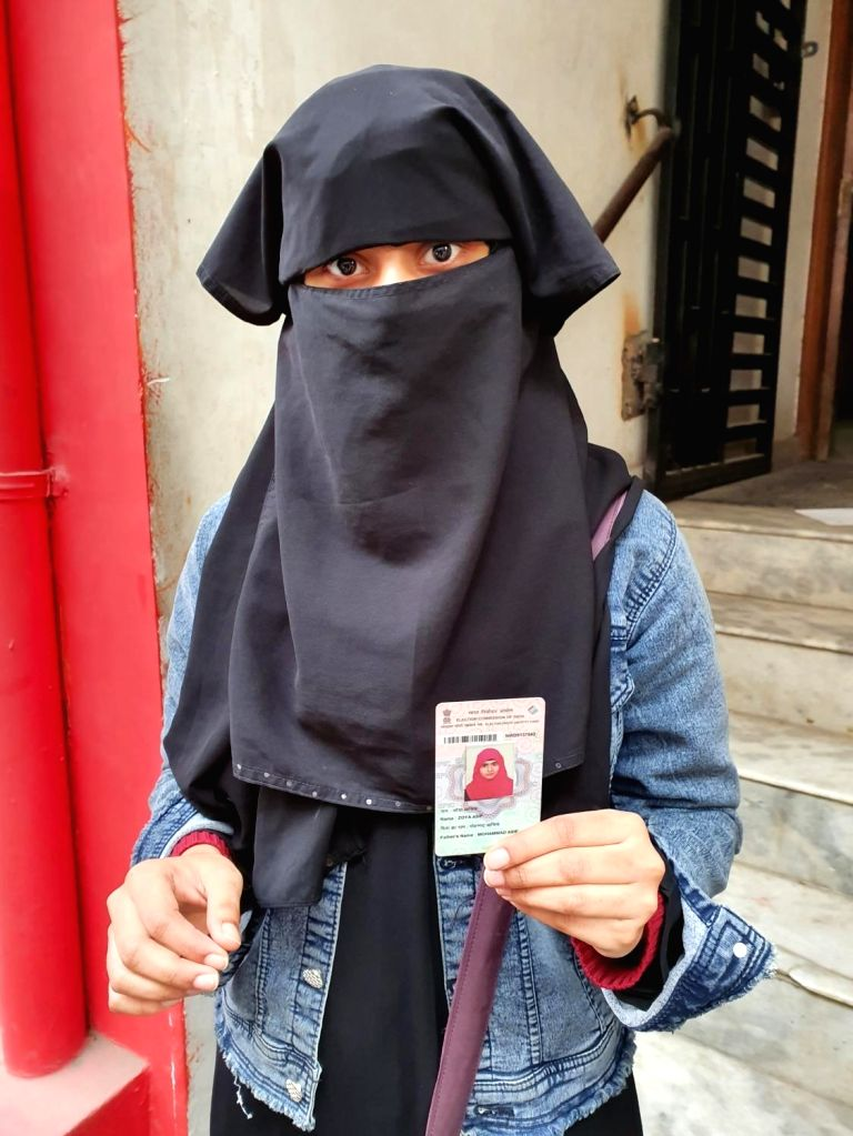 New Delhi: A first time voter shows her Voter ID during Delhi Assembly elections 2020, at a polling station at Delhi's Shaheen Bagh on Feb 8, 2020. (Photo: IANS)