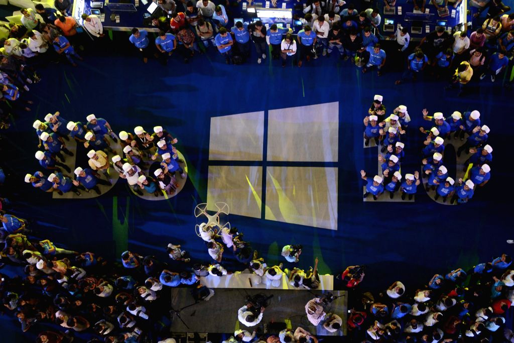 New Delhi: A group of people stand in a formation of `Do Windows 10` during the launch of Microsoft Windows 10, in New Delhi, on July 29, 2015. (Photo: IANS)