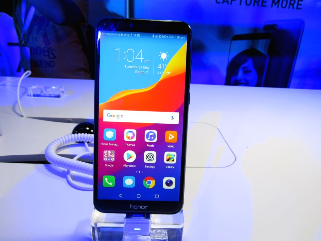 :New Delhi: A Huawei Honor smatphone on display during the launch of Huawei Honor 7A and Honor 7C smartphones, in New Delhi on May 22, 2018. (Photo: IANS).