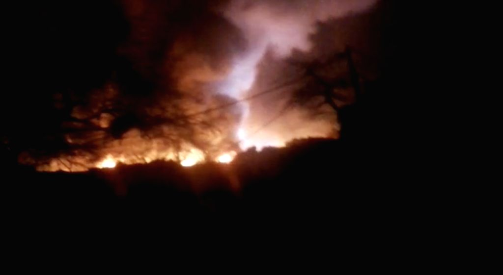 New Delhi: A massive fire breaks out in the Shaheed Bhagat Singh Camp at Paschim Puri of west Delhi gutting at least 250 shanties on Feb 13, 2019. The Delhi government has announced Rs 25,000 for each of the affected families along with food and tent - Bhagat Singh Camp