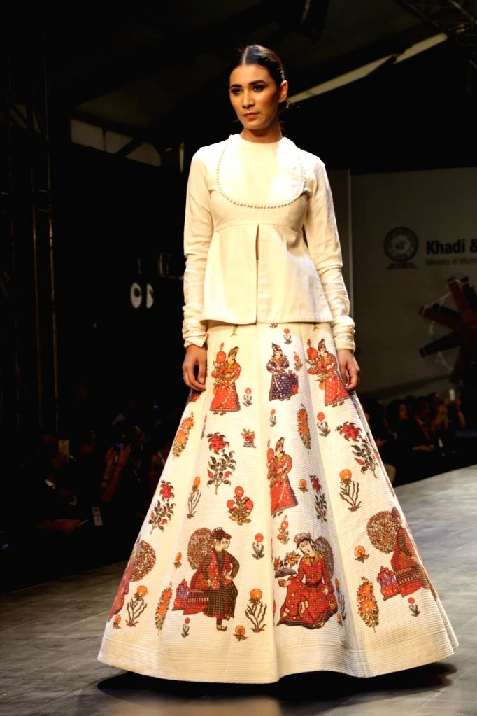 """:New Delhi: A model showcases creation of fashion designer Rohit Bal collections at FDCI Fashion Show """"Khadi - Transcending Boundaries"""" in collaboration with KVIC as a part of SME Convention 2018 ..."""
