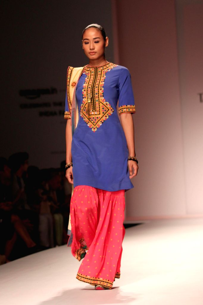 A model showcases fashion designer Tanvi Kedia`s creations during Amazon India Fashion Week in New Delhi, on March 27, 2015.