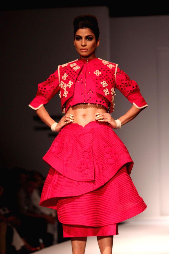 A model showcases fashion designer Sahil Kochhar`s creations during Amazon India Fashion Week in New Delhi, on March 28, 2015.