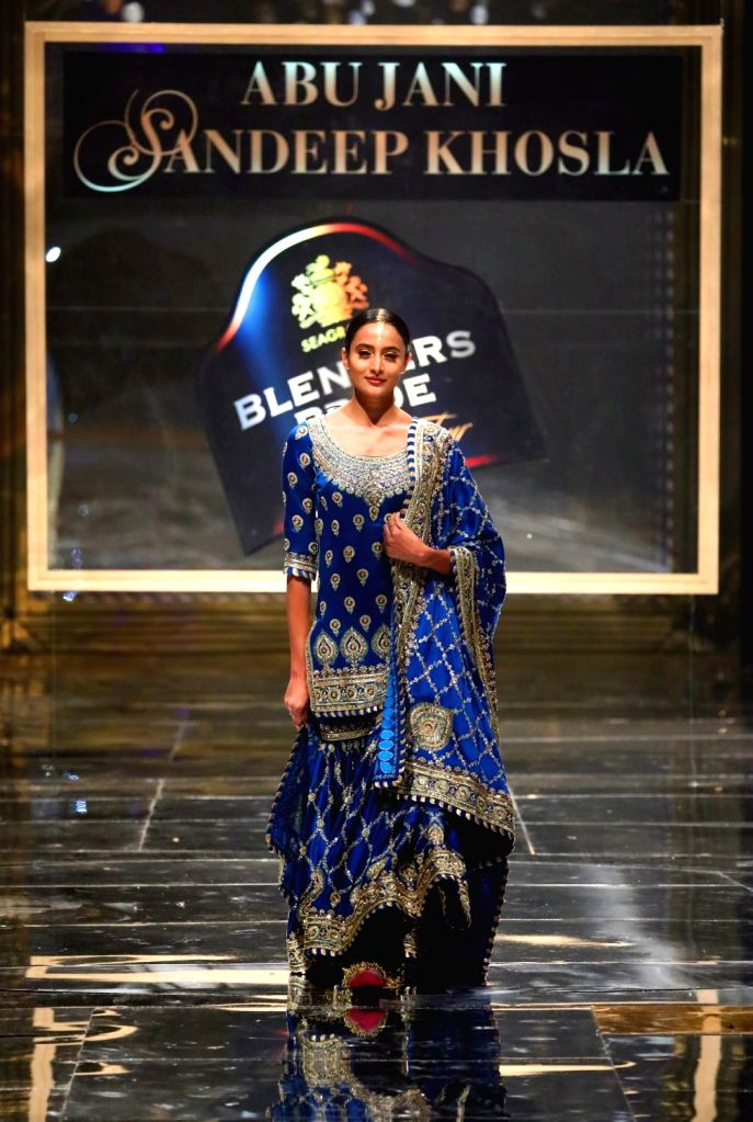 New Delhi: A model walks the ramp at the 15th edition of the Blenders Pride Fashion Tour 2019-20 in New Delhi. (Photo: IANS)