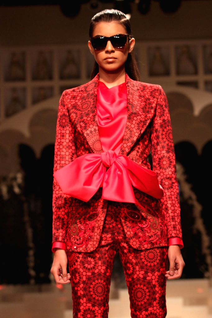 A model walks the ramp during The Grand Finale of Amazon India Fashion Week 2015 in New Delhi on March 29, 2015.