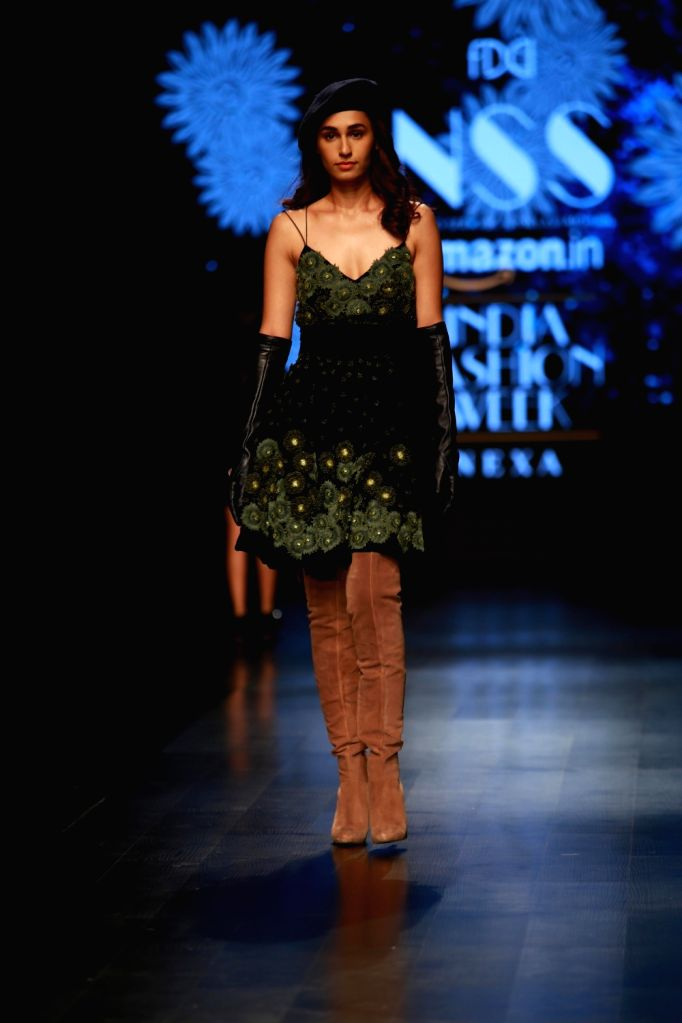 New Delhi: A model walks the ramp showcasing fashion designer Pallavi Mohan's creation during the second day of Amazon India Fashion Week in New Delhi on March 15, 2018. (Photo: Amlan Paliwal/IANS)