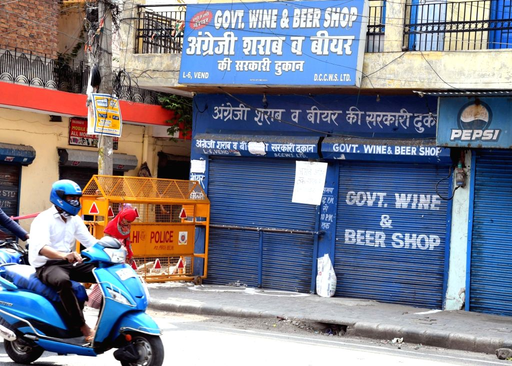 """New Delhi: A notice that reads """"liquor shops shall remain closed till further orders"""" put up by the police on the shutter of a wine and beer shop in East Delhi during the extended nationwide lockdown imposed to mitigate the spread of coronavirus, on"""