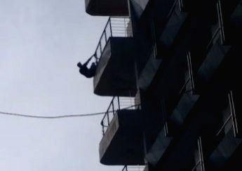 New Delhi: A person hanging from the tenth floor of the Delhi's Signature Hotel.