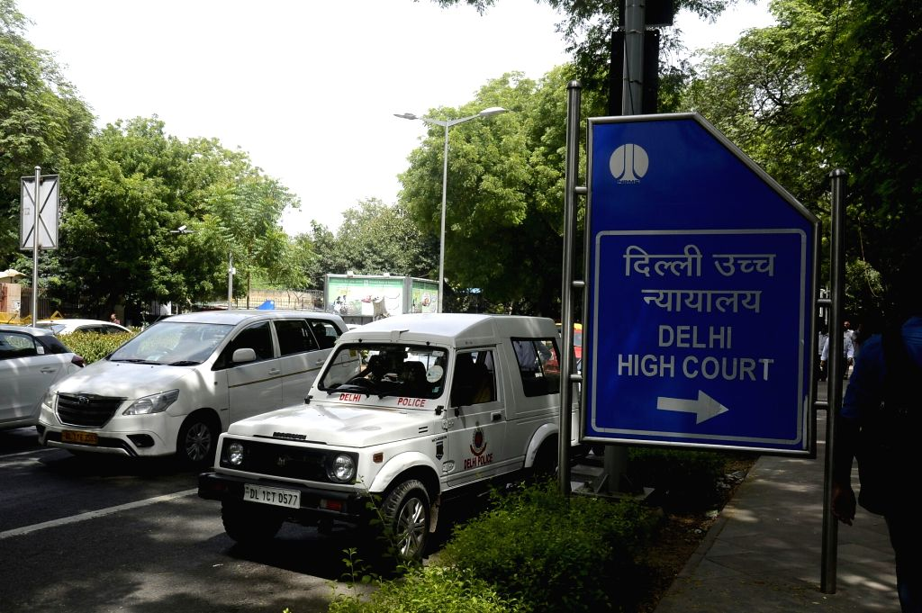 New Delhi: A police jeep and fire tender outside the Delhi High court after an anonymous caller warned of a bomb explosion in the premises which turned out to be a hoax, in New Delhi on Aug 17, 2017. (Photo: IANS)