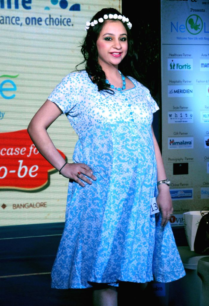 A pregnant woman walks the ramp during a programme in New Delhi, on May 3, 2015.