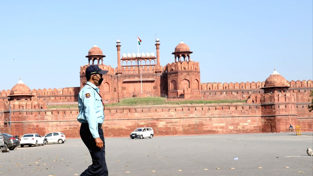 New Delhi: A security guard seen wearing a mask as a precautionary measure against COVID-19 outside the Red Fort which has been closed on Government orders as a measure to contain coronavirus, in New Delhi on March 17, 2020. (Photo: IANS)