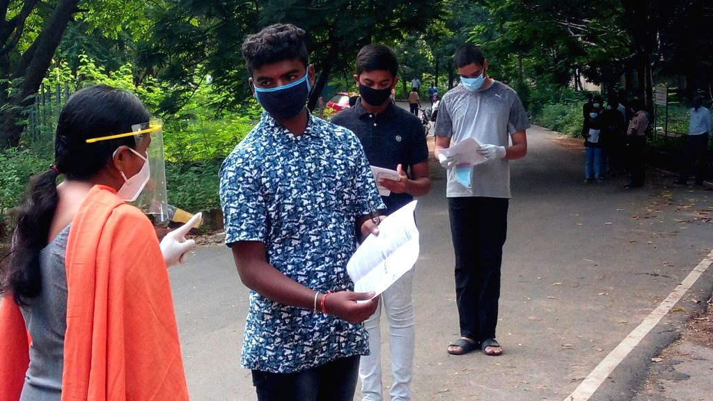 New Delhi: A student appearing  for the Telangana State Engineering, Agriculture & Medical (Pharmacy, Veterinary) Common Entrance Test enquires about his query outside the examination center in Hyderabad on Sep 9, 2020. All Covid-19 protocols, includ