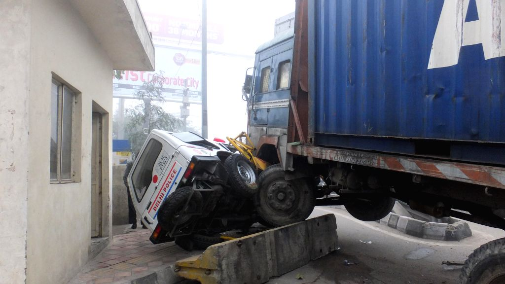 A sub-inspector died and two other Delhi Police personnel injured as a container truck rams into a PCR van near Mayur Vihar Extension, New Delhi on Jan 13, 2014.
