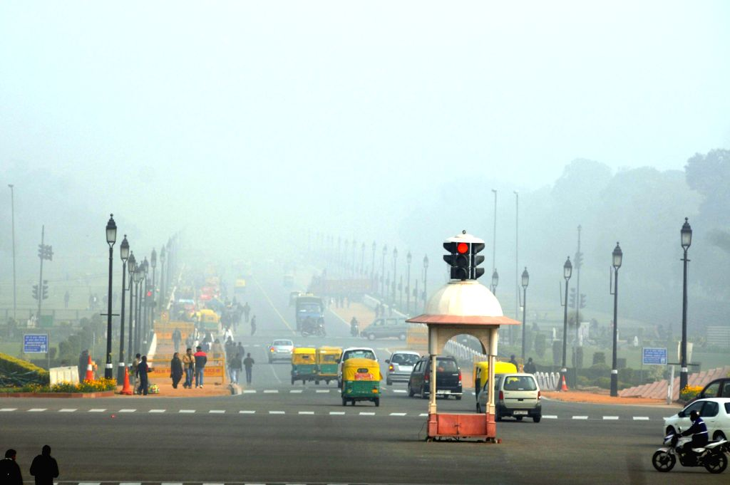 A view of Raj Path on a foggy morning in New Delhi, on Dec 21, 2014.