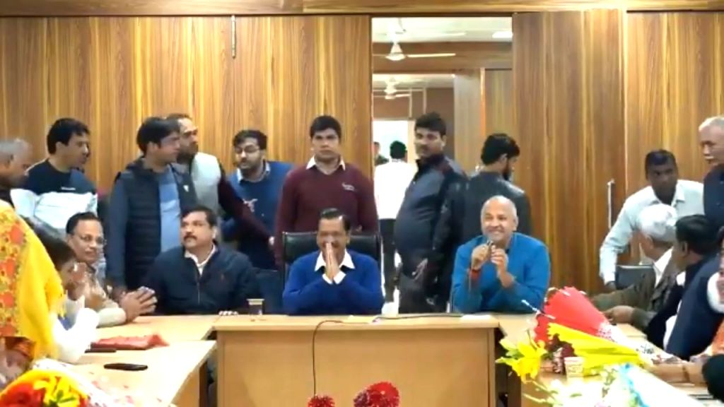 New Delhi: Aam Aadmi Party (AAP) chief Arvind Kejriwal elected as the leader of the AAP legislative party in the Assembly by the party's 62 newly elected MLAs during a meeting at his residence, in New Delhi on Feb 12, 2020. Also seen AAP MLA elect Ma - Arvind Kejriwal and Sanjay Singh