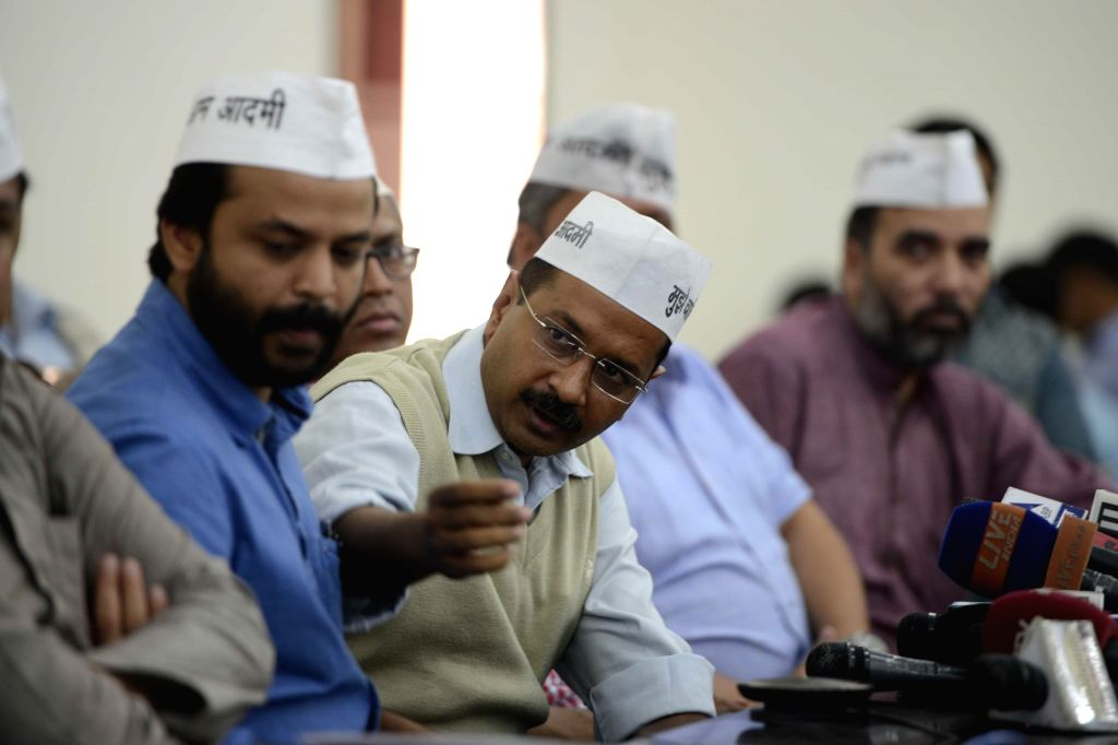 Aam Aadmi Party (AAP) leader Arvind Kejriwal during a press conference in New Delhi, on Nov 12, 2014. Also seen party leaders Ashish Khetan and Gopal Rai. - Arvind Kejriwal and Gopal Rai