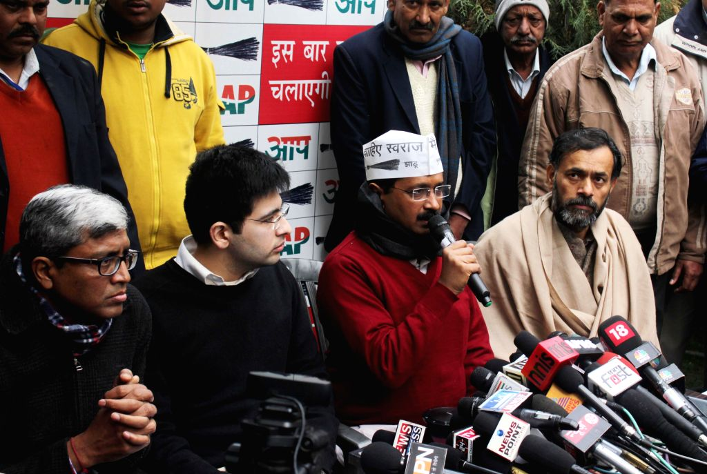 Aam Aadmi Party (AAP) leader Arvind Kejriwal addresses a press conference at North Avenue in New Delhi, on Jan 14, 2015. Also seen party leaders Yogendra Yadav, Ashutosh and others. - Arvind Kejriwal and Yogendra Yadav