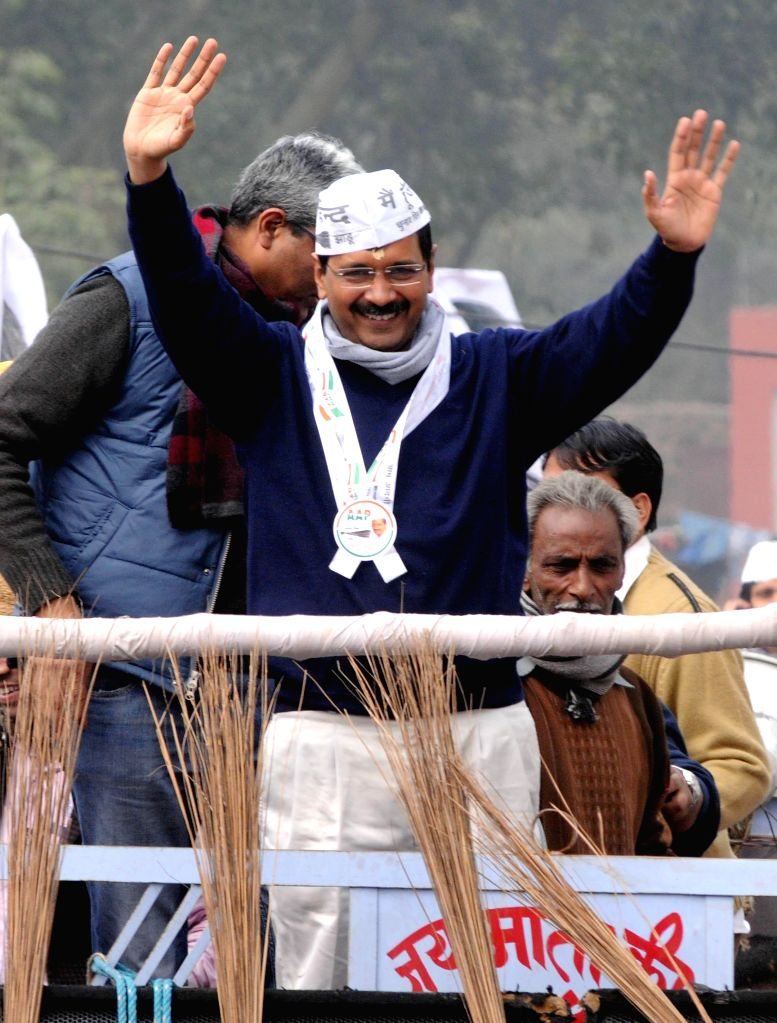 Aam Aadmi Party (AAP) leader Arvind Kejriwal during a roadshow ahead of filing his nominations papers for upcoming Delhi Assembly polls in New Delhi, on Jan 20, 2015.