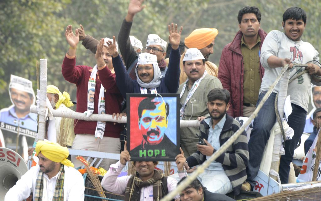 Aam Aadmi Party (AAP) leader Arvind Kejriwal during a roadshow ahead of filing his nominations papers for upcoming Delhi Assembly polls in New Delhi, on Jan 20, 2015. Also seen party ... - Arvind Kejriwal and Sanjay Singh