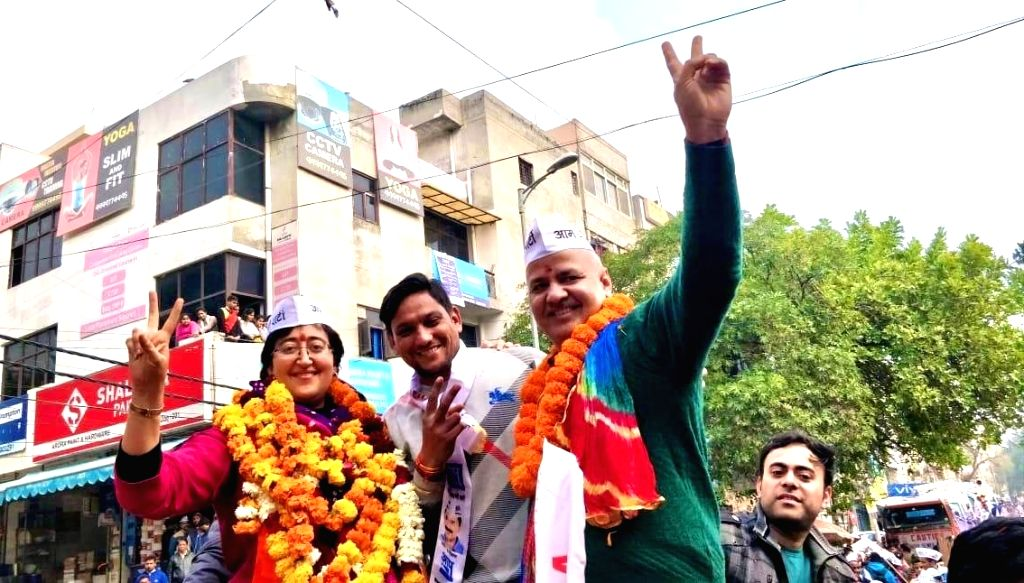 New Delhi: Aam Aadmi Party (AAP) leader Atishi Marlena with Delhi Deputy Chief Minister Manish Sisodia after filing her nomination papers from Kalkaji constituency ahead of Delhi Assembly elections, in New Delhi on Jan 17, 2020. (Photo: IANS) - Manish Sisodia