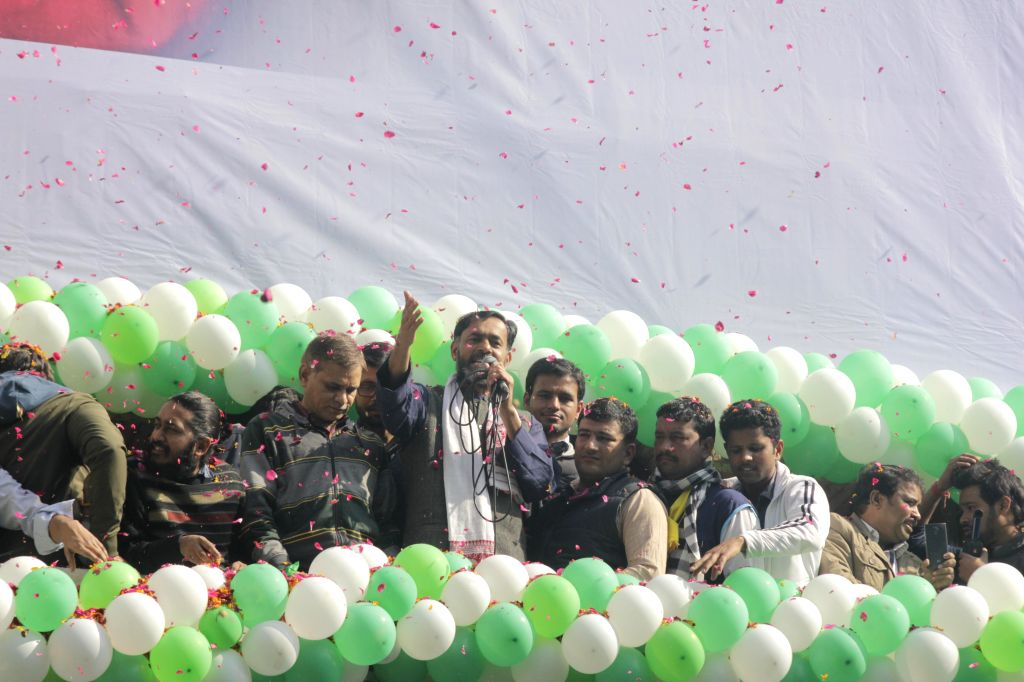 Aam Aadmi Party (AAP) leader Yogendra Yadav celebrate party`s performance in the recently concluded Delhi Assembly Polls at Patel Nagar in New Delhi, on Feb 10, 2015. - Yogendra Yadav