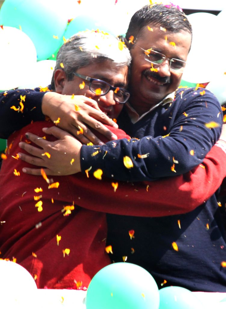 Aam Aadmi Party (AAP) leaders Arvind Kejriwal and Ashutosh celebrate party's performance in the recently concluded Delhi Assembly Polls in New Delhi, on Feb 10, 2015. - Arvind Kejriwal