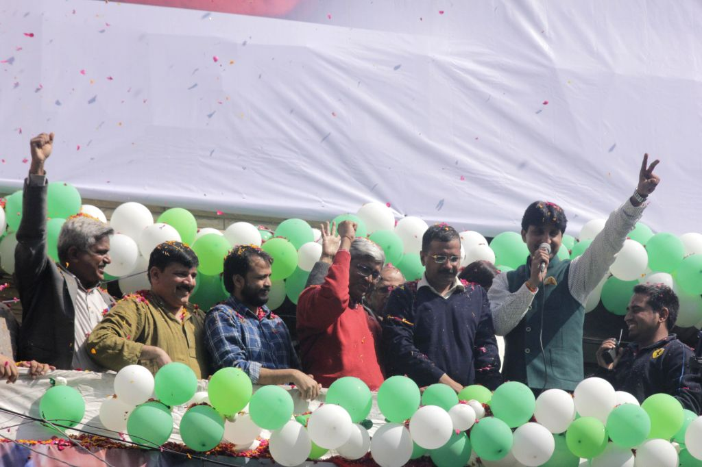 Aam Aadmi Party (AAP) leaders Arvind Kejriwal and Kumar Vishwas celebrate party`s performance in the recently concluded Delhi Assembly Polls at Patel Nagar in New Delhi, on Feb 10, 2015. - Arvind Kejriwal