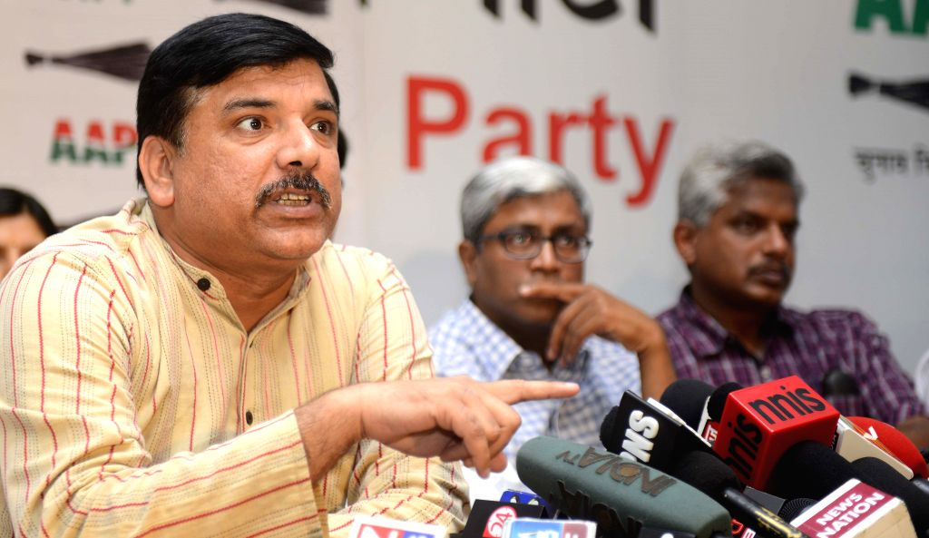 Aam Aadmi Party (AAP) leaders Sanjay Singh and Ashutosh during a press conference in New Delhi on April 21, 2015. - Sanjay Singh