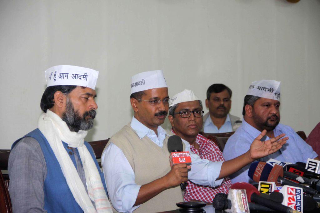 Aam Aadmi Party (AAP) leaders Yogendra Yadav, Arvind Kejriwal, and Ashutosh during a press conference in New Delhi, on Nov 12, 2014. - Yogendra Yadav and Arvind Kejriwal