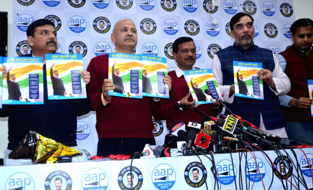 New Delhi: Aam Aadmi Party (AAP) National Convener Arvind Kejriwal, Cabinet Ministers Manish Sisodia and Gopal Rai and party leader Sanjay Singh release the party's election manifesto for the February 8 Delhi Assembly polls, at the party's headquarte - Manish Sisodia, Gopal Rai, Convener Arvind Kejriwal and Sanjay Singh