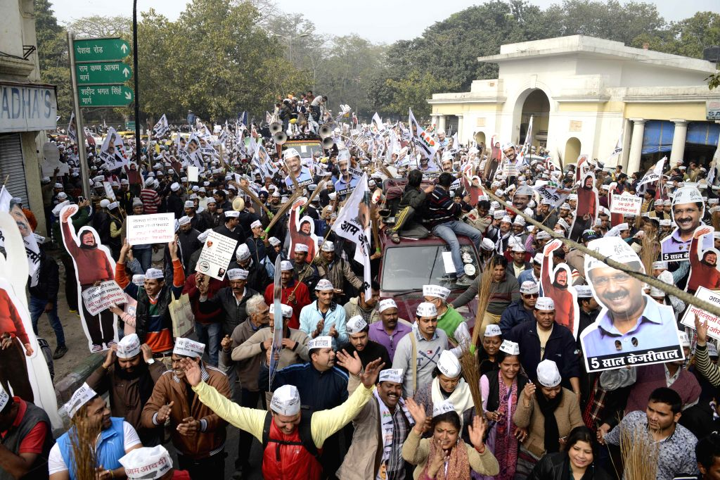 Aam Aadmi Party (AAP) supporters participate in Arvind Kejriwal's roadshow in New Delhi, on Jan 20, 2015. - Arvind Kejriwal