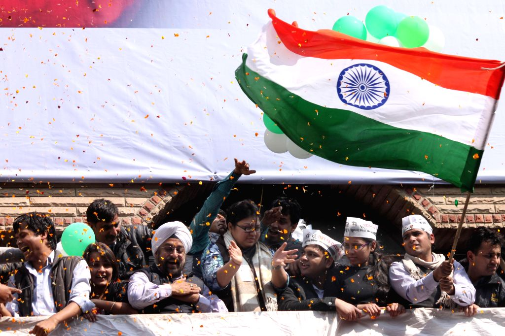Aam Aadmi Party (AAP) supporters celebrate party's victory in the recently concluded Delhi Assembly Polls in New Delhi, on Feb 10, 2015.
