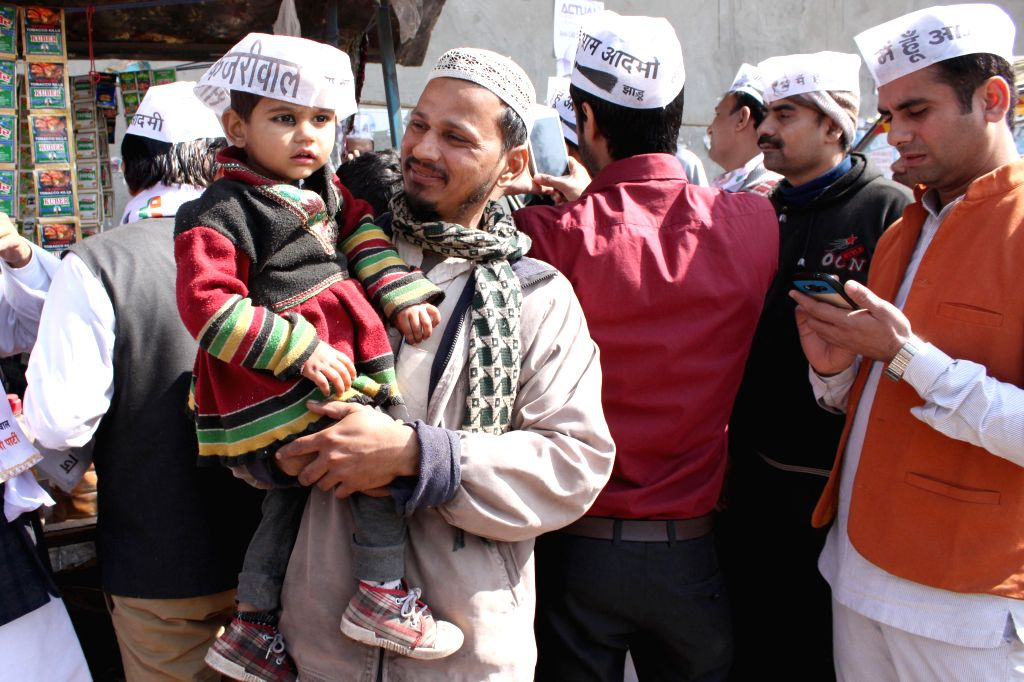 Aam Aadmi Party (AAP) workers campaigns for the party at Shaheen Bagh in Okhla, New Delhi on Feb 5, 2015.